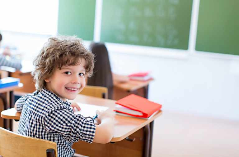 Boy at a desk in classroom